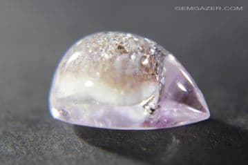 Amethyst cabochon with Cristobalite inclusions, Brazil. 3.53 carats.