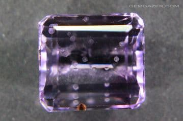 Amethyst with Cristobalite inclusion, faceted, Brazil.  4.36 carats.