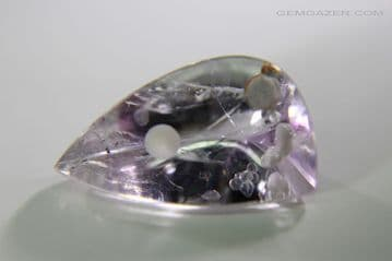 Amethyst with Cristobalite inclusion, faceted, Brazil.  5.40 carats.