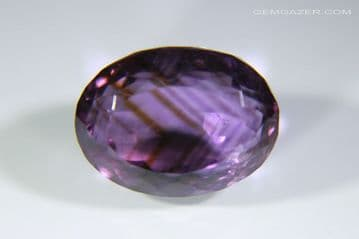 Amethyst with 'Tiger-Stripe' colour zoning, faceted, Brazil.  8.78 carats.