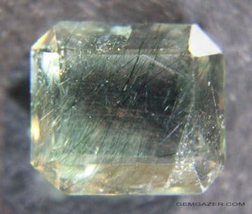 Apatite, yellow with Actinolite inclusions, faceted, Pakistan.  6.47 carats. ** SOLD **
