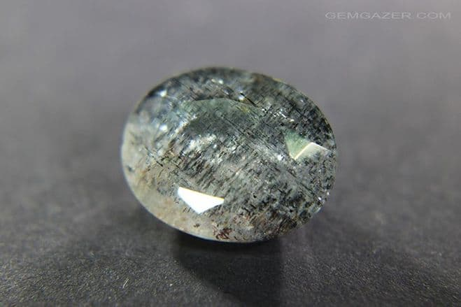 Aquamarine with Hematite & Goethite inclusions, faceted, Brazil.  4.90 carats. ** SOLD **