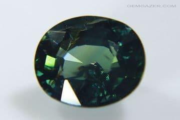 Bi-colour blue and green Sapphire, faceted, Australia. 0.99 carat. (See Video)