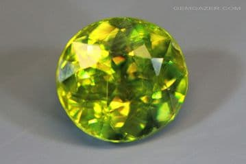 Chrome Sphene (Titanite), faceted, Namibia. 1.99 carats. (See Video)