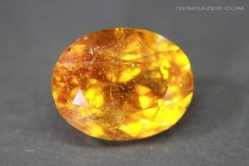 Clinohumite, faceted, Tajikistan.  9.59 carats.  ** SOLD **