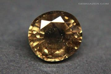 Colour-change Garnet, honey-brown to red, faceted, Tanzania. 1.72 carats.