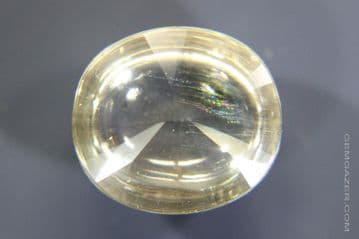 Colourless Topaz cabochon with Iridescent needle inclusions, Myanmar. 13.27 carats. ** SOLD **