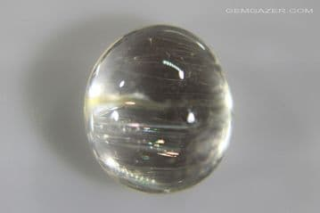 Colourless Topaz cabochon with Iridescent needle inclusions, Myanmar. 6.79 carats. ** SOLD **