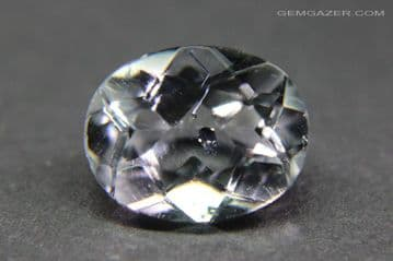 Colourless Topaz with Columbite inclusions, faceted, Brazil.  3.26 carats. ** SOLD **