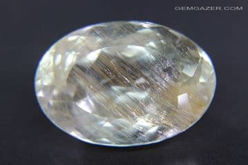 Colourless Topaz with golden yellow Limonite inclusions, faceted, Brazil. 26.26 carats.