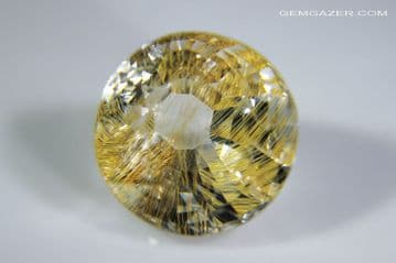 Colourless Topaz with golden yellow Limonite inclusions, faceted, Myanmar, 9.39 carats. ** SOLD **