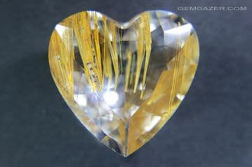 Colourless Topaz with golden yellow Limonite inclusions, faceted, Pakistan.  40.40 carats.