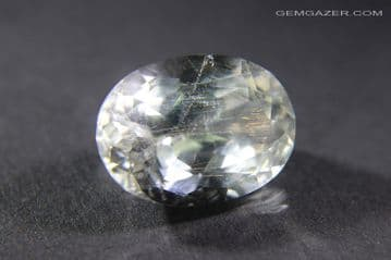 Colourless Topaz with Iridescent needle inclusions, faceted, Madagascar. 11.00 carats. (See Video)