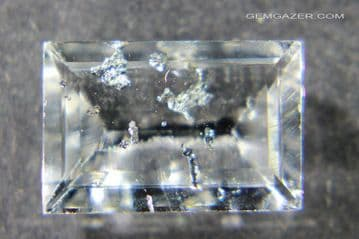 Colourless Topaz with Tantalite inclusions, faceted, Brazil.  4.43 carats. ** SOLD **