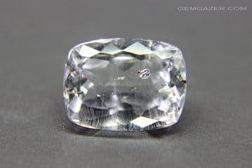 Colourless Topaz with Tantalite inclusions, faceted, Brazil. 9.48 carats.
