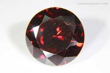 Cubic Zirconia (CZ), dark red faceted. 6.07 carats.