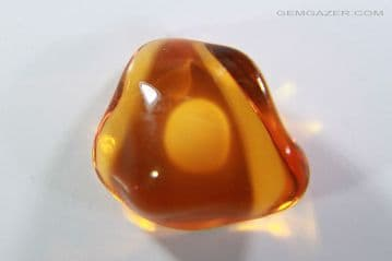 """Fire Opal cabochon with """"egg"""" inclusion, Mexico. 1.63 carats. ** SOLD **"""
