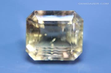 Fluorite, smoky-yellow faceted, fluorescent, County Durham, England. 102.17 carats. (Video)