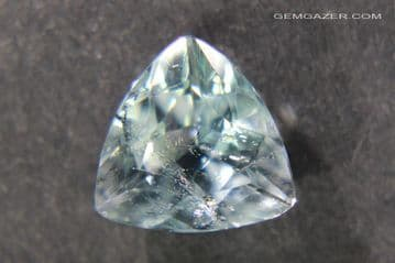 Pale blue Topaz with Columbite needle inclusions, faceted, Brazil.  4.79 carats.
