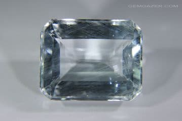 Pale blue Topaz with iridescent needle inclusions, faceted, Brazil. 19.77 carats.