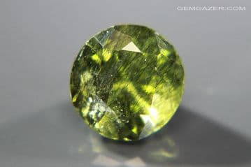 Peridot with Ludwigite-Vonsenite inclusions, green faceted, Pakistan. 4.60 carats.