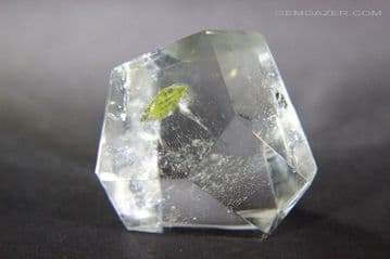 Polished Quartz crystal with greenish-yellow  Sphene inclusion, Brazil. 55.97 carats.