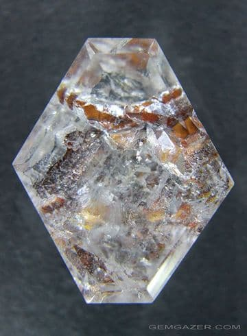 Quartz with oxide-coated positive crystal inclusions, faceted, Brazil.  88.42 carats.