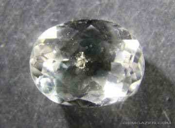 Quartz with Pyrite crystal inclusion, faceted, Brazil.  3.47 carats.
