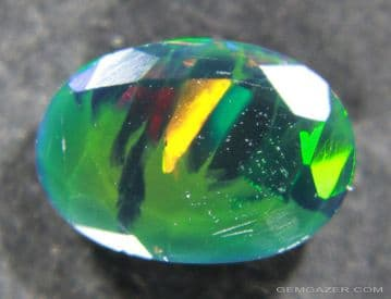 Smoke-treated black Opal, faceted, Ethiopia.  1.28 carats.  ** SOLD **