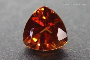 Synthetic orange Sapphire, Verneuil (flame-fusion) method, faceted. 2.52 carats.