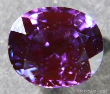 Synthetic purple Sapphire, faceted, 4.96 carats.  ** SOLD **