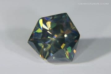 Synthetic Rutile, steel-grey blue, faceted. 3.00 carats.