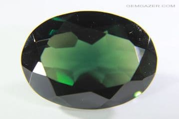 Synthetic Spinel, Verneuil method, dark Tourmaline green faceted. 14.09 carats.