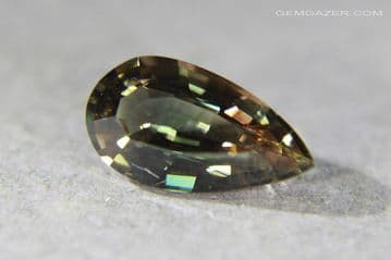 Teal -green and orange-brown dichroic Sunstone, faceted, USA. 2.12 carats. ** SOLD **