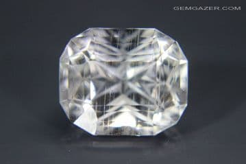 Topaz , colourless with needle inclusions, faceted, Madagascar. 13.94 carats. (See Video)